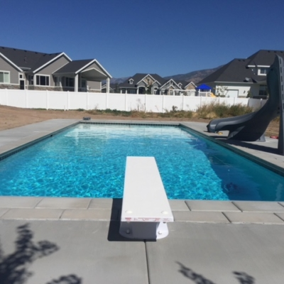 pool with diving board and slide