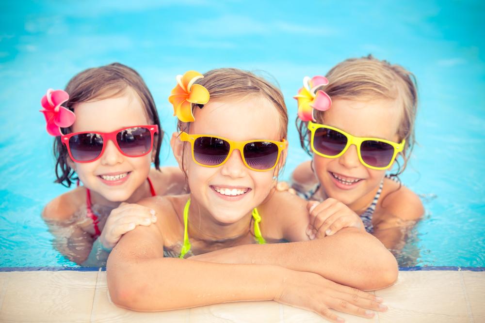 kids having fun in their custom swimming pool design utah